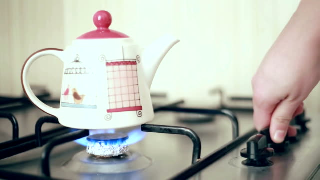 steaming teapot - stove stock videos & royalty-free footage