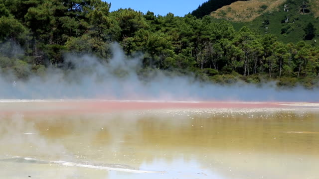 steaming water at champagne pool, waiotapu thermal reserve, rotorua - thermal pool stock videos & royalty-free footage
