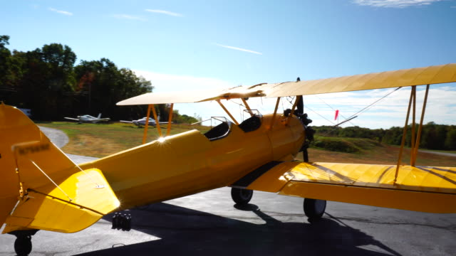 stearman classic yellow biplane - biplane stock videos & royalty-free footage