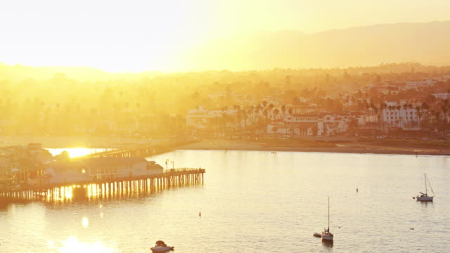 Stearns Wharf, Santa Barbara and the Santa Ynez Mountains at Sunset - Drone Shot