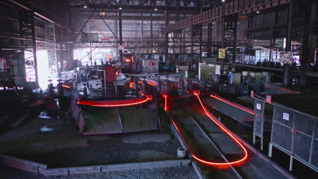 steel bars been shaped at a large steel factory in africa - cable stock videos & royalty-free footage