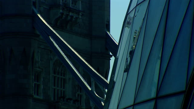 steel beams seem to attach tower bridge to london city hall. available in hd. - gla building stock videos & royalty-free footage