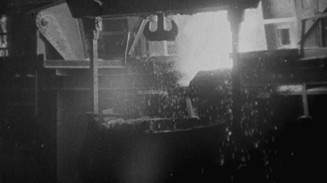 1940 montage steel being forged into munitions, steel workers, and steel mill exteriors during world war ii / united kingdom - metal industry stock videos and b-roll footage