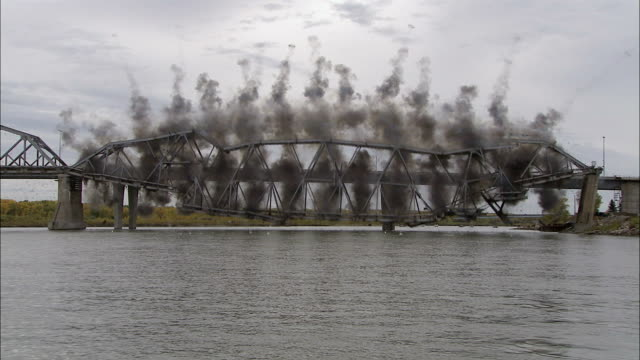 WS Steel bridge collapsing  into river and birds flying off  / Bismarck, North Dakota, USA