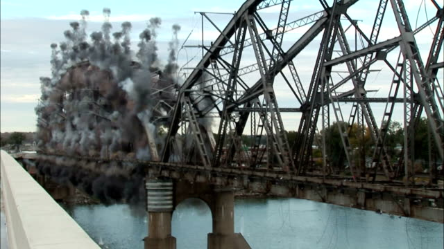 ms steel bridge collapsing into river  in controlled implosion with  explosives / bismarck, north dakota, usa - bismarck north dakota stock videos & royalty-free footage