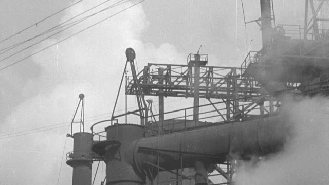 td steel factory industrial exterior, with steam billowing - 1931年点の映像素材/bロール