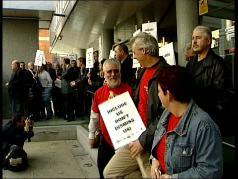 corus job cuts; itn england: london: ext cms union officals carrying sacks containing demands for boss of steel firm corus to be sacked to entrance... - annual general meeting stock videos & royalty-free footage