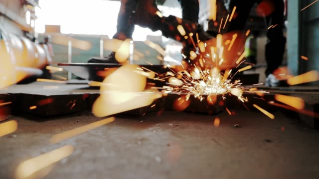 steel industry workers grinding a sheet of metal - skill stock videos & royalty-free footage