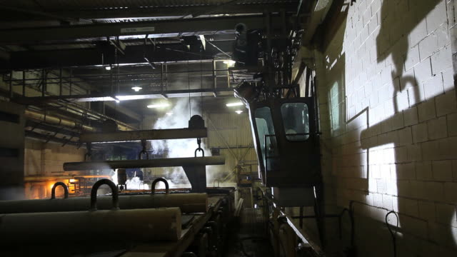 steel manufacturing- coils being moved - steel mill stock videos & royalty-free footage