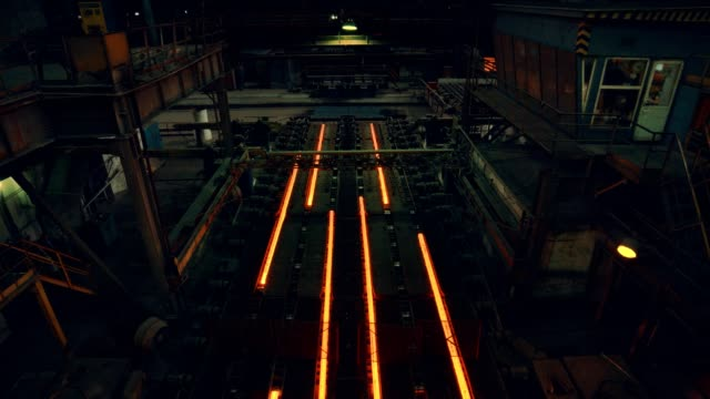 steel mill factory - iron bar after molding are folded for cooling - steel mill stock videos & royalty-free footage