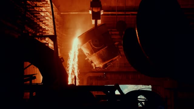 steel mill factory - molten metal in vat - foundry stock videos & royalty-free footage