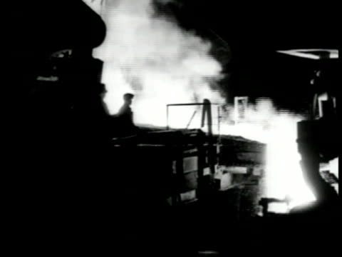 steel mill int ws silhouette of workers molten steel pouring sparks fire cu poster 'european recovery' ms worker unloading cotton bales from freight... - webstuhl stock-videos und b-roll-filmmaterial