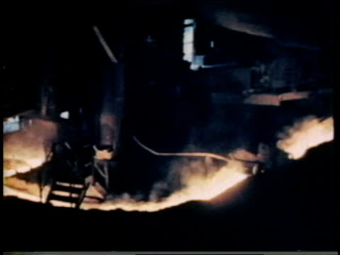 1941 MONTAGE Steel mill production with lots of sparks and glowing hot molten metal / United States