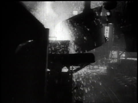 vídeos de stock, filmes e b-roll de 1939 montage steel mill with machines moving and fire and sparks flying / japan - indústria metalúrgica