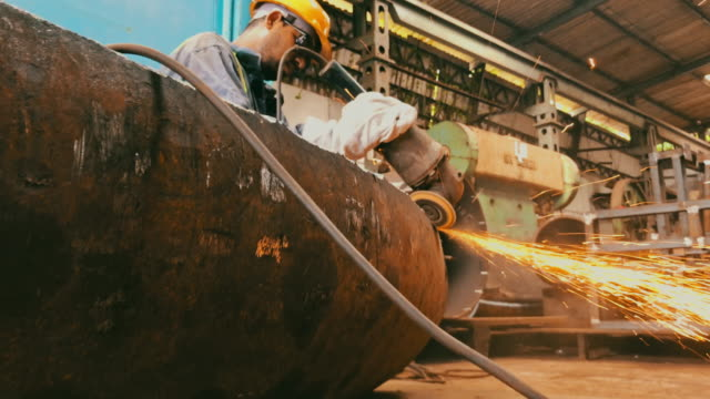 steel pipe factory worker grinding the semi finished pipe - steel worker stock videos & royalty-free footage