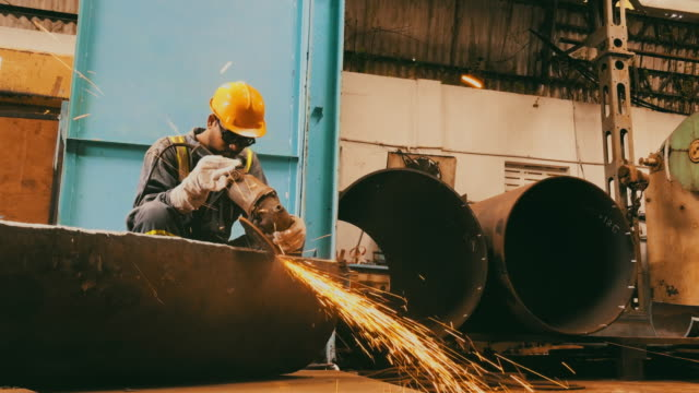 steel pipe factory worker grinding the semi finished pipe - mill stock videos & royalty-free footage