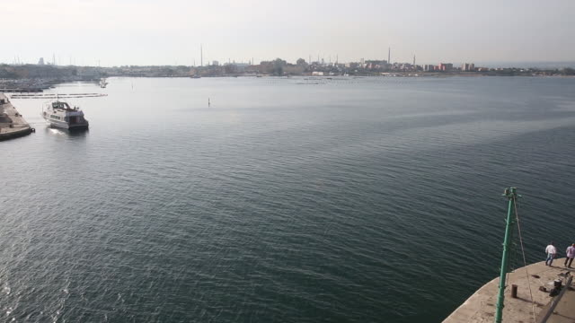 ilva steel plant fishermen repairing fishnets and views of the port and city in taranto italy on tuesday may 22 2018 - taranto province stock videos & royalty-free footage