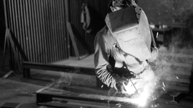 vídeos de stock, filmes e b-roll de montage steel prop reclamation welders using welding machines / grimesthorpe, south yorkshire, united kingdom - superexposto