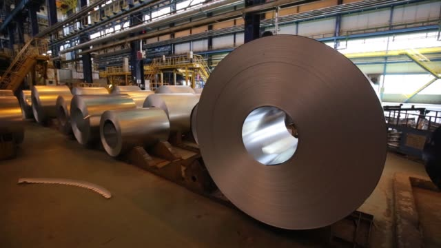 vidéos et rushes de steel rolls sit on railway freight wagons ready for shipping at the cherepovets steel mill, operated by severstal pjsc, in cherepovets, russia, on... - acier