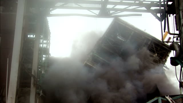 ms  steel skeleton of building is demolished in controlled implosion using explosives andand  dissappearing cloud of dust / vancouver, british columbia, canada - imploding stock videos and b-roll footage
