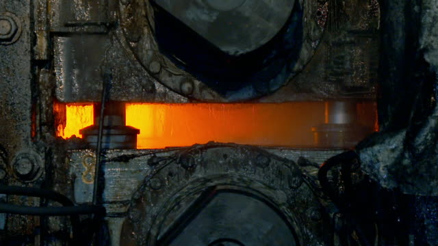 steel slabs move along assembly line in steelworks - furnace stock videos & royalty-free footage