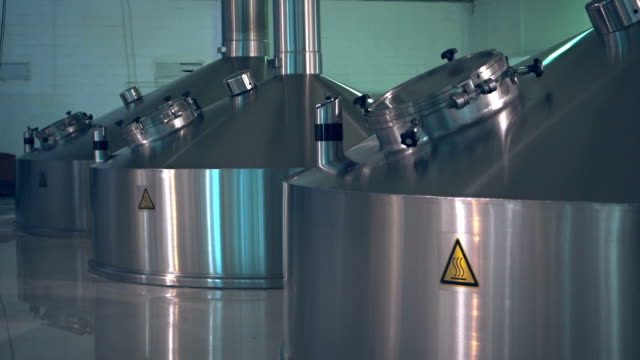 steel tanks for beer brewing and storage - fermenting stock videos and b-roll footage