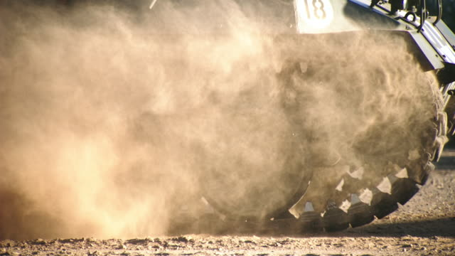CU SLO MO TS Steel wheels rolling and debris from ground as M18 Hellcat tank drives / Peoria, Arizona, United States