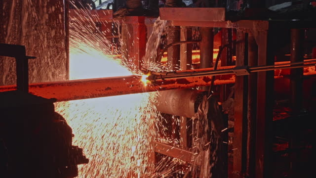 steel worker manually cutting the steel billets using a gas cutter - metal industry stock videos & royalty-free footage