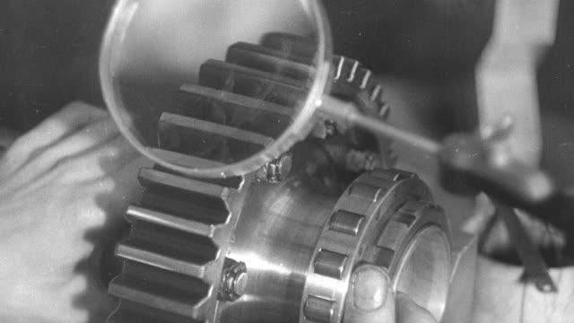 montage steel worker testing gear for an airplane / united kingdom - 品質管理点の映像素材/bロール