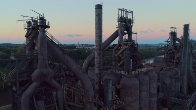 steelstacks - the historic steel plant converted into the modern cultural center in bethlehem, pennsylvania. aerial drone video with the panoramic camera motion. - smoke stack stock videos & royalty-free footage