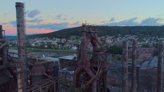 steelstacks - the historic steel plant converted into the modern cultural center in bethlehem, pennsylvania. aerial drone video with the wide orbit camera motion. - history stock videos & royalty-free footage