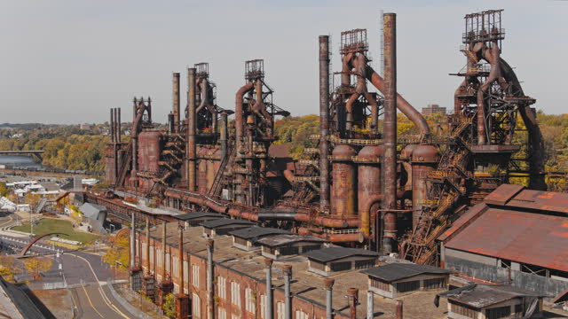 steelstacks - the historic steel plant, once abandoned but now converted into the modern cultural center in bethlehem, pennsylvania. aerial drone video with the forward-panoramic complex camera motion. - steel stock videos & royalty-free footage