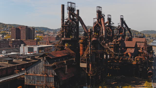 steelstacks - the historic steel plant, once abandoned but now converted into the modern cultural center in bethlehem, pennsylvania. aerial drone video with the cinematic panning-orbiting camera motion. - ruined stock videos & royalty-free footage