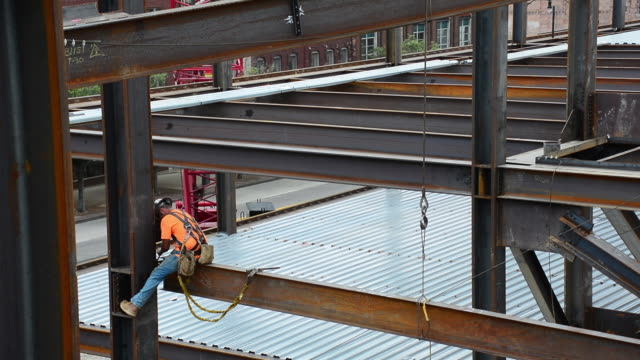 a steelworker sits on the edge of a support beam at a 12story commercial site in columbus ohio - steel stock videos & royalty-free footage
