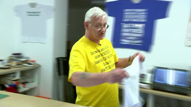 steelworkers prepare to lobby mps to save their industry; england: teesside: redcar: int set-up shots of dave stones printing t-shirts with slogan... - only girls stock videos & royalty-free footage