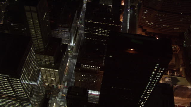 steep aerial look down into new york city street at night. shot in 2005. - artbeats stock videos & royalty-free footage