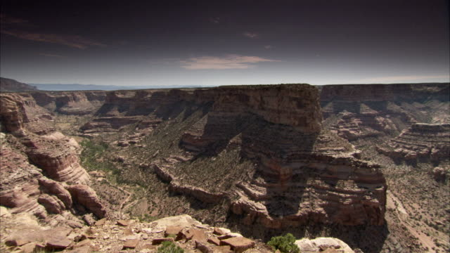 steep canyons and rocky cliffs fill a vast desert. available in hd - shrubland stock videos & royalty-free footage