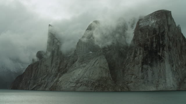 Steep Cliffs And Low Clouds On Coast
