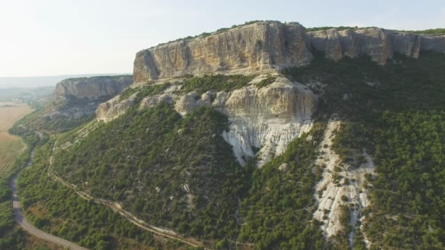 aerial: steep cliffs of canyon - multicopter stock videos & royalty-free footage