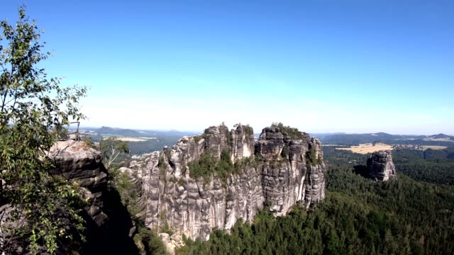 steep climbing rocks with mountain forest, sandstone mountains, tourist destination, pan - sandstone stock videos & royalty-free footage