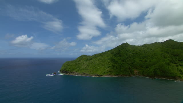 Steep coastal cliffs near Petite Soufriere on the island of Dominica.