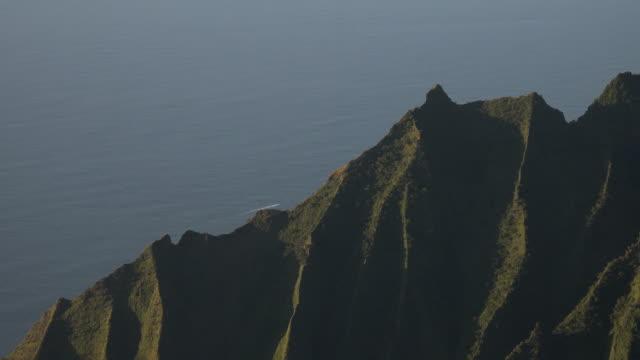 steep mountain sides on kauai island - butte rocky outcrop stock videos & royalty-free footage