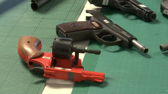 Steep rise in gun crime across London ENGLAND London INT Various shots guns on table Detective Chief Superintendent Jim Stockley interview SOT...