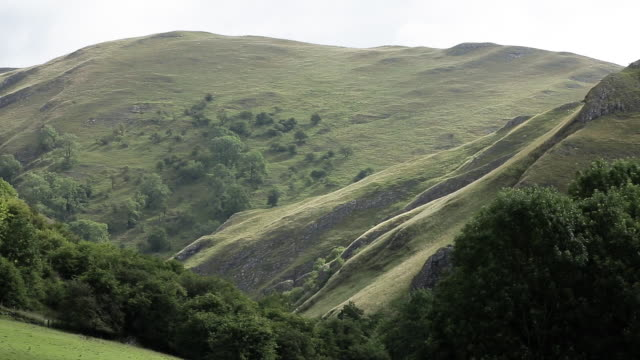 steep sided hills in peak district bathed in sunshine - steep stock videos & royalty-free footage