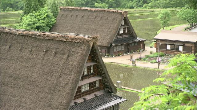steep thatched-roofed houses occupy the historic villages of shirakawago and gokayama, japan. - 世界遺産点の映像素材/bロール