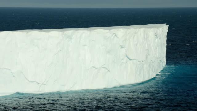 steep vertical edge of arctic iceberg - berg stock videos & royalty-free footage