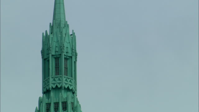 a steeple on a new york city building is topped with a tall spike. - steeple stock videos & royalty-free footage