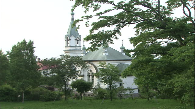 a steeple towers over the haristos orthodox church in hakodate, japan. - steeple stock videos & royalty-free footage