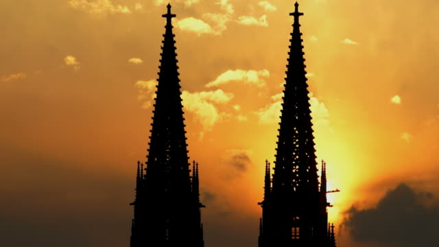 cu t/l steeples of a gothic cathedral at sunset - regensburg stock videos & royalty-free footage