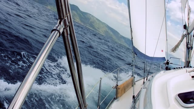 hd: steering through the waves - sailing stock videos & royalty-free footage